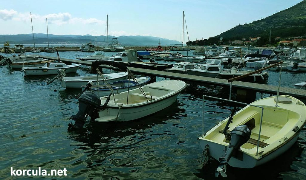 Local marina harbouring numerous small motor boats. Some of them are available for hire too
