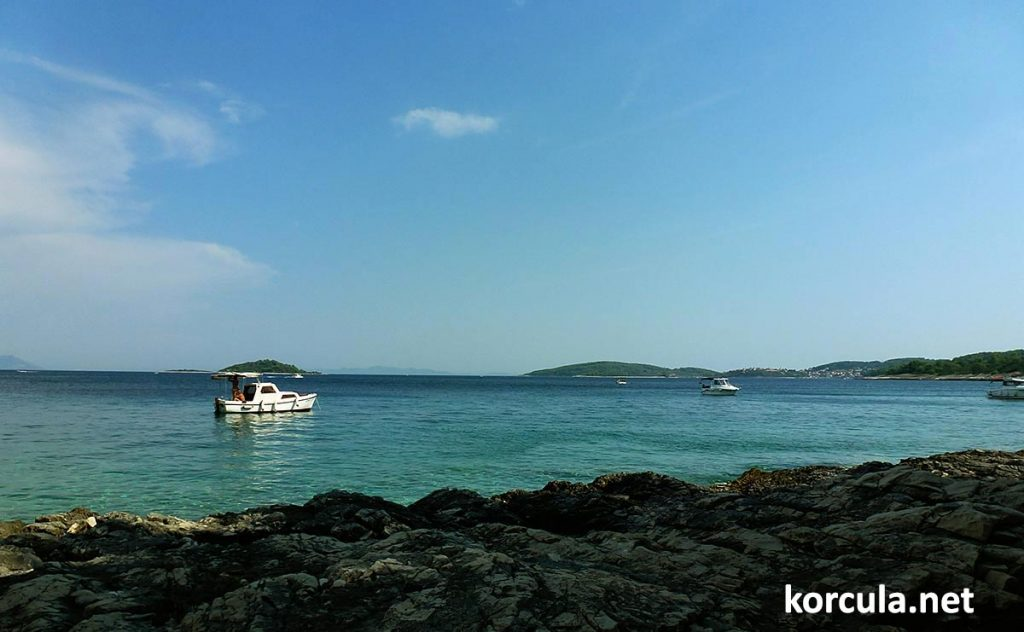 several small motor boats anchored off shores of Badija islet in the local archipelago